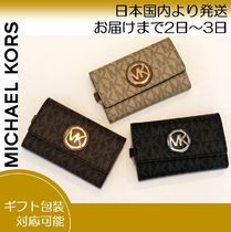 Michael Kors Monogram Leather Keychains & Bag Charms