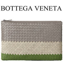 BOTTEGA VENETA Stripes Leather Clutches