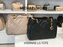 Michael Kors A4 Leather Totes