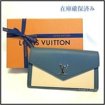 Louis Vuitton LOCKME Calfskin Long Wallets