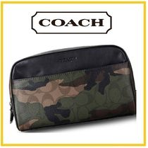 Coach Camouflage Clutches