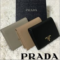 PRADA Calfskin Folding Wallets