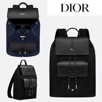 Christian Dior Unisex Calfskin Plain Backpacks