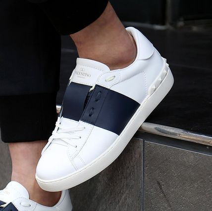 Shop VALENTINO Street Style Sneakers by