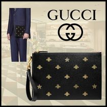 GUCCI Star Studded Bag in Bag Leather Clutches