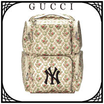 GUCCI Flower Patterns Leather Backpacks