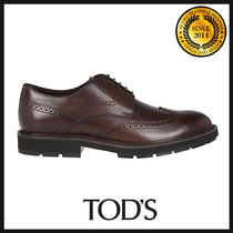 TOD'S Wing Tip Leather Oxfords