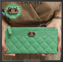 CHANEL ICON Unisex Lambskin Plain Pouches & Cosmetic Bags