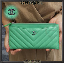 CHANEL ICON Unisex Calfskin Plain Pouches & Cosmetic Bags