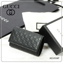 GUCCI Monogram Unisex Leather Keychains & Bag Charms