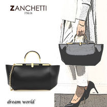 ZANCHETTI Plain Leather Handbags