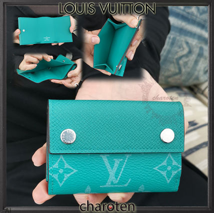 2618a7e83627 Monogram Unisex Canvas Folding Wallets. Louis Vuitton. Monogram Unisex  Canvas Folding Wallets