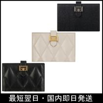GIVENCHY Plain Leather Folding Wallets