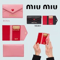 MiuMiu Heart Leather Keychains & Bag Charms
