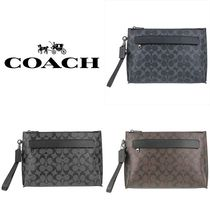 Coach Monogram PVC Clothing Clutches