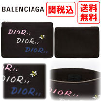Christian Dior Street Style Clutches