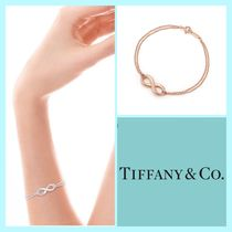 Tiffany & Co TIFFANY INFINITY 18K Gold Elegant Style Bracelets
