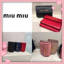 MiuMiu Plain Leather Folding Wallets