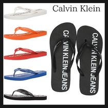 Calvin Klein CALVIN KLEIN JEANS Unisex Street Style Shower Shoes PVC Clothing Shower Sandals