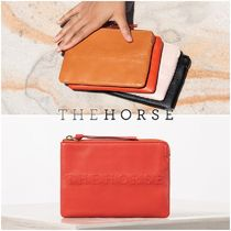 The Horse Plain Leather Clutches