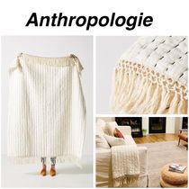 Anthropologie Plain Geometric Patterns Throws