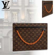 Louis Vuitton Street Style Clutches