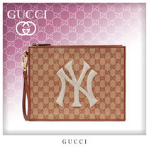 GUCCI Unisex Canvas Street Style Bag in Bag Clutches