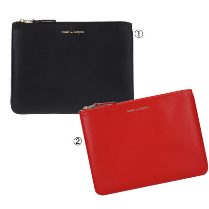 Unisex Plain Leather Clutches