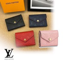 Louis Vuitton Leather Logo Folding Wallets