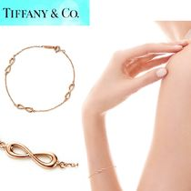 Tiffany & Co TIFFANY INFINITY 18K Gold Bracelets