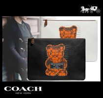Coach SIGNATURE Clutches