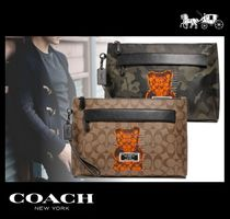 Coach SIGNATURE Monogram Street Style Bag in Bag Clutches