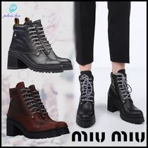 MiuMiu Glen Patterns Mountain Boots Round Toe Rubber Sole