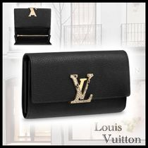 Louis Vuitton TAURILLON Blended Fabrics Leather Python Long Wallets