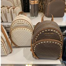 Michael Kors Casual Style Studded A4 Leather Dark Brown Logo Backpacks