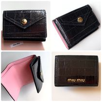 MiuMiu Folding Wallets