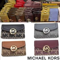 Michael Kors Unisex Leather Keychains & Bag Charms