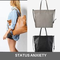 STATUS ANXIETY Totes