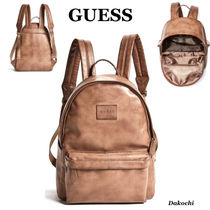 Guess Faux Fur Backpacks