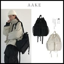 shop aake bags