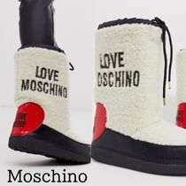 Moschino Round Toe Rubber Sole Mid Heel Boots