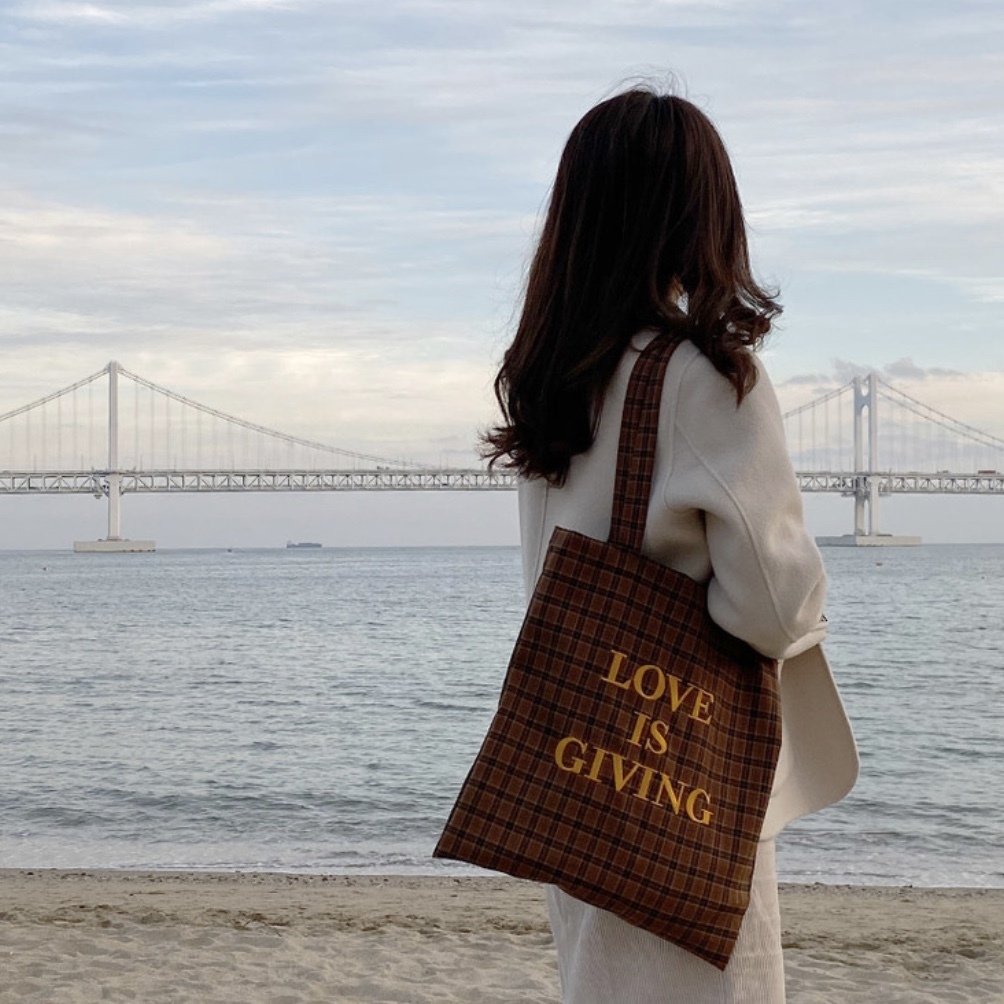 shop love is giving bags
