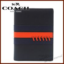 Coach Passport Cases