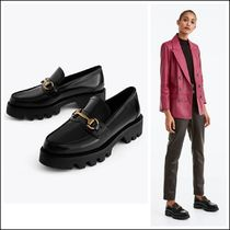 Uterque Black Leather Loafers with Track Sole