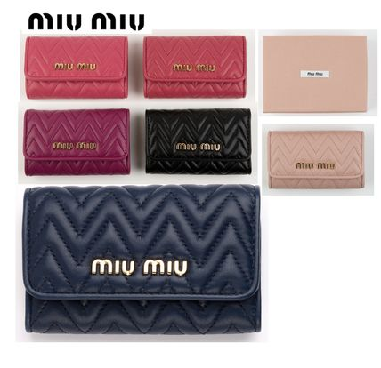 MiuMiu Leather Logo Keychains & Bag Charms