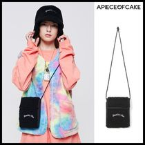 A PIECE OF CAKE Shoulder Bags