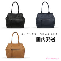 shop status anxiety bags