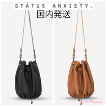 STATUS ANXIETY Shoulder Bags