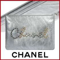 CHANEL Calfskin Leather Logo Metallic Pouches & Cosmetic Bags