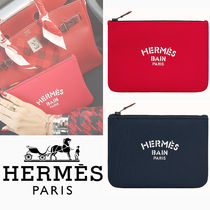 HERMES Unisex Canvas Logo Pouches & Cosmetic Bags